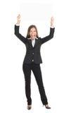 Commercieel vrouw opgewekt holdings wit teken Royalty-vrije Stock Foto