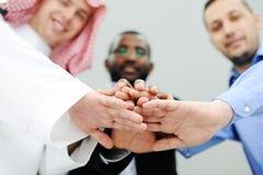 Commerciële team overlappende handen Royalty-vrije Stock Afbeelding
