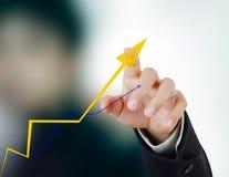 Commercio che tocca con il grafico di statistiche Fotografia Stock