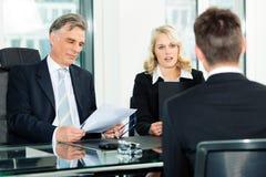 Commercio - intervista di job Fotografie Stock