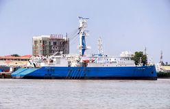 Industrial Commerical Cargo Ship Vietnam. A Commerical cargo ship docked along the mekong river in south vietnam on a sunny afternoon day royalty free stock image