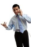 Commesso dell'uomo d'affari che comunica sul telefono Immagine Stock Libera da Diritti