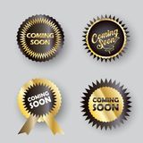 Comming Soon sticker tag logo set. Gold Coming soon - labels set, unique stamp symbols, decorative modern round frames, icons, stickers, logo elements Stock Images