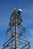 Comminication mast. Communication tower with blue sky behind Royalty Free Stock Photography