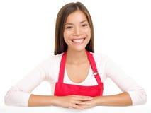 Commis d'aide de ventes de femme de tablier Images stock
