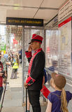 Commissionaire at Lego bus stop Royalty Free Stock Photo