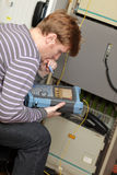 Commissioning of fibre optic. IT technician commissioning of fibre optic by analyser Royalty Free Stock Photography
