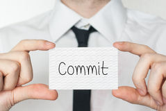Commit. Businessman holding business card Royalty Free Stock Image