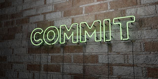 COMMIT - Glowing Neon Sign on stonework wall - 3D rendered royalty free stock illustration Stock Images