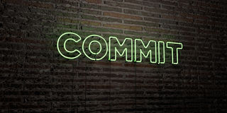 COMMIT -Realistic Neon Sign on Brick Wall background - 3D rendered royalty free stock image Royalty Free Stock Photos