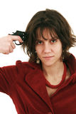 Commit suicide. Woman with red jacket holding a gun on temple isolated on white Royalty Free Stock Photo