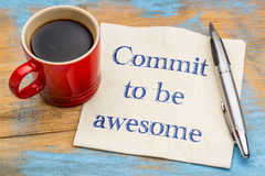 Commit to be awesome - napkin concept. Commit to be awesome - handwriting on a napkin with a cup of coffee Stock Photography