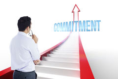 Commitment against red arrow with steps graphic Stock Image