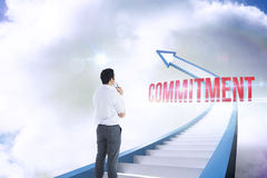 Commitment against red staircase arrow pointing up against sky Stock Photo