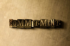 COMMITMENT - close-up of grungy vintage typeset word on metal backdrop Stock Photography