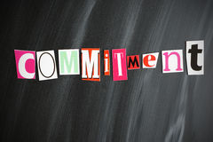 COMMITMENT. Colorful COMMITMENT letters on Chalkboard Royalty Free Stock Images