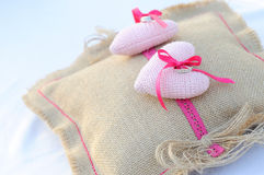 Commitment rings on pillow sackcloth Royalty Free Stock Photo