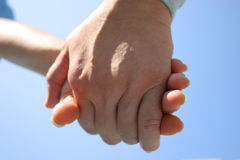 Committed. Husband holding his wife's hand Stock Photography