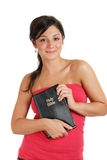 Committed christian holding a bible and smiling Royalty Free Stock Photography