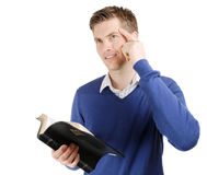 Committed christian reading bible and thinking. This is an image of a man reading the bible and thinking stock photography