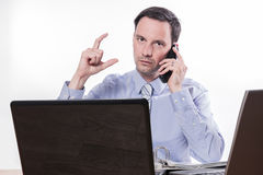 Committed employee giving stock market call sign Royalty Free Stock Photo