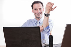 Committed employee pulling up sleeves Royalty Free Stock Photos