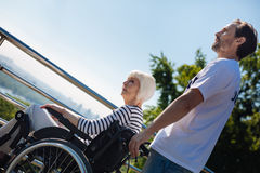 Committed gallant man taking care of elderly people Stock Images