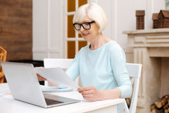 Committed professional lady perusing a report Royalty Free Stock Photography