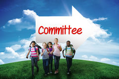 Committee against green hill under blue sky Stock Images