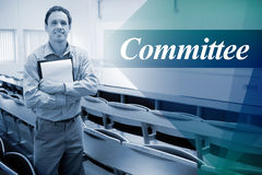 Committee against male teacher with notepad in the lecture hall Royalty Free Stock Image