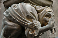 The committee has come to a unanimous decision about your work!. Gargoyle on the wall of City Hall (Rathaus) in Munich, Germany Stock Images