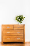 Commode with flowers Royalty Free Stock Photo