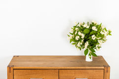 Commode with flowers Stock Photo