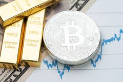 Commodity and alternative asset, gold bar and crypto currency Bi. Tcoin on rising price graph as financial crisis or war safe haven, investment asset or wealth stock photography