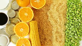 Commodity close up with coffee, milk, metal, oranges, corn, rice and soybeans royalty free stock photos