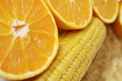 Commodity close up with organic oranges for orange juice, corn, full grain rice and organic rice stock image