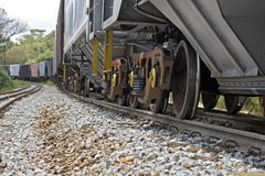 Train perspective from the viewpoint of wheels and rail Royalty Free Stock Image