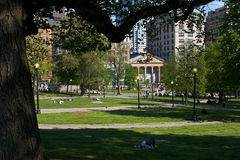 The common. Scenic view of the boston common on a sunny day showing trees, grass, walkways and people laying on the grass Stock Image