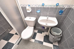 Common Bathroom. A wide angle photo taken on a tidy well kept common bathroom Royalty Free Stock Photo