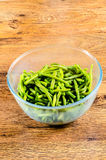 Common bean on glass cup. On wooden table Royalty Free Stock Photos