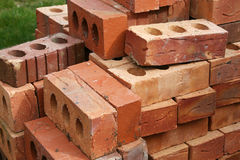 Common building bricks. Common house building bricks stacked ready for use stock photos