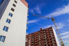 Free Common City Building Construction Facade Foreshortening From Below Perspective Exterior Urban View With Crane Industrial Object On Stock Images - 179921434