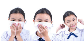 Common cold little asia girl with facemask Stock Image