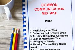 Common communication mistake you are doing concept. With topics on a coversheet Stock Photography