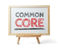 Common Core. Whiteboard with text Common Core is isolated on the white background royalty free stock photography