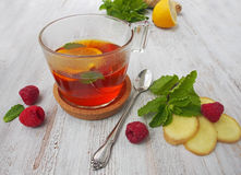 Common cure for common cold - lemon, mint, raspberry, ginger Stock Photos