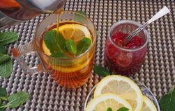 Common cure for common cold - lemon, mint, raspberry jam Stock Photography