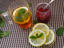 Common cure for common cold - lemon, mint, raspberry jam Royalty Free Stock Photos