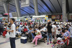 A common day and travellers pending in Beijing South Railway station Royalty Free Stock Images