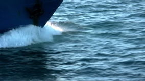 The common dolphins jump with the bow of a trawler stock video footage